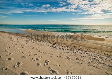 Beautiful Beach with Footprints - stock photo