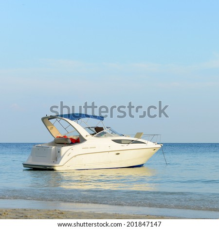 Beautiful beach with motor boat at Samed island, Thailand - stock photo