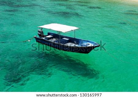 Beautiful beach with motor boat at Tioman island, Malaysia - stock photo
