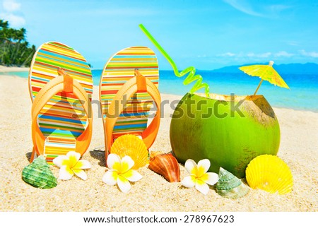 Beautiful beach with palms and cocktail - stock photo