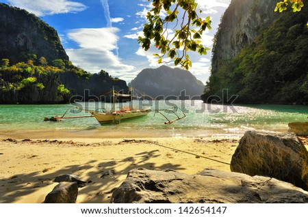 Beautiful beach with rocks on the background of the islands.El Nido, Philippines - stock photo