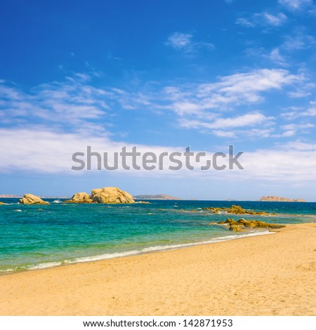 beautiful beach with turquoise water under blue  sky - stock photo