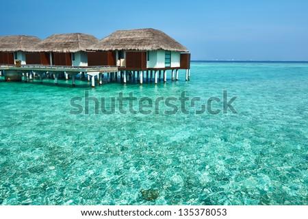 Beautiful beach with water bungalows at Maldives - stock photo