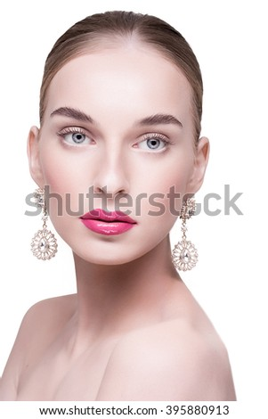 beautiful beautiful white woman with earrings on a white background, with bared shoulders - stock photo