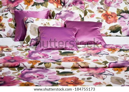 Beautiful beddings with pink floral design - stock photo