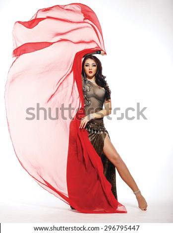 Beautiful belly dancer in the studio - stock photo