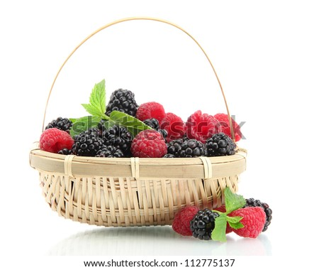beautiful berries with leaves in basket isolated on white - stock photo