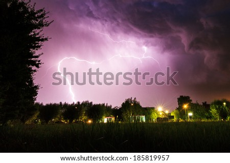 Beautiful big flash of lightning in the night sky over Baambrugge in the Netherlands - stock photo