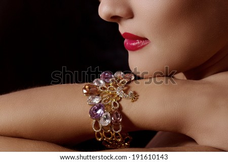 Beautiful bijouterie bangles on hand. Fashion photo - stock photo