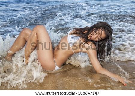 Beautiful bikini woman at the beach - stock photo