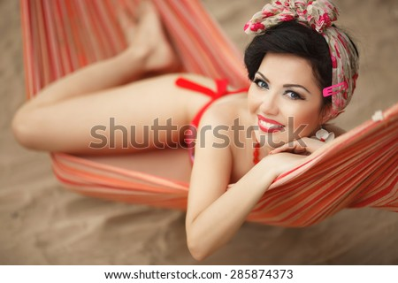 Beautiful bikini woman pinup outdoors portrait happy girl retro style at vacation at beach, smiling female summer portrait, elegant lady pin up, soft retro tonality, series - stock photo