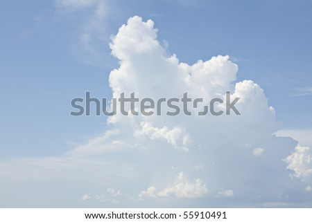 Beautiful billowing white clouds on blue sky - stock photo