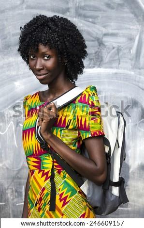 Beautiful Black African Girl Posing with Sack Blackboard  - stock photo