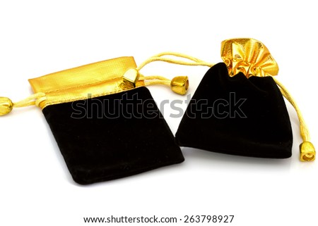 Beautiful Black and gold Velvet Pouch to hold Jewelry and Delicate items isolated on White Background - stock photo