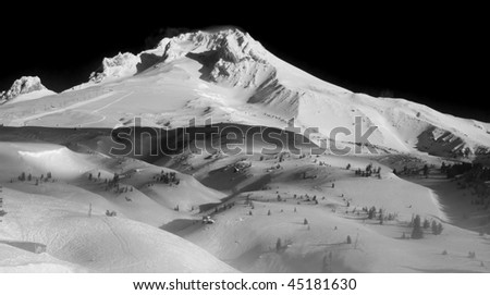 Beautiful Black and White Vista of Mount Hood in the Pacific Northwest with the wind blowing through the snow. - stock photo