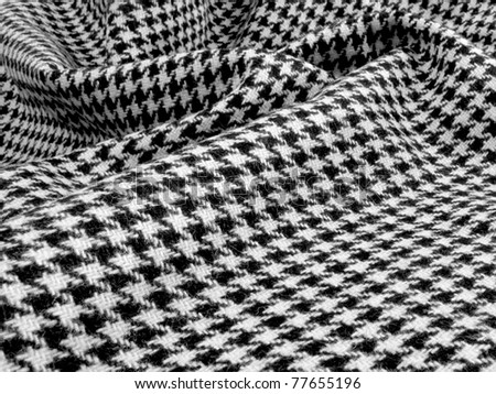 Beautiful black and white wool houndstooth swirled - stock photo