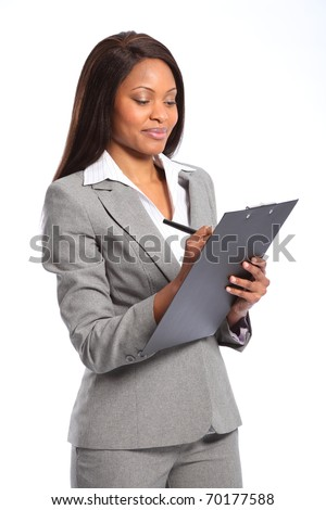 Beautiful black business woman with clipboard - stock photo