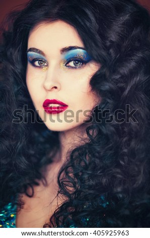 Beautiful black-haired girl with bright;makeup and glitters, bachelorette party, cocktail party, closeup portrates - stock photo