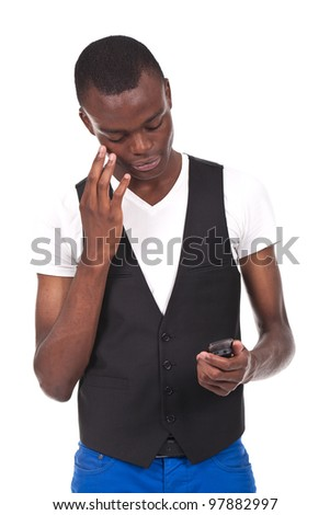 beautiful black man holding a phone and looking worried - stock photo