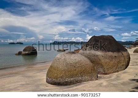 Beautiful black sand beach with boulders. Langkawi, Malaysia. - stock photo