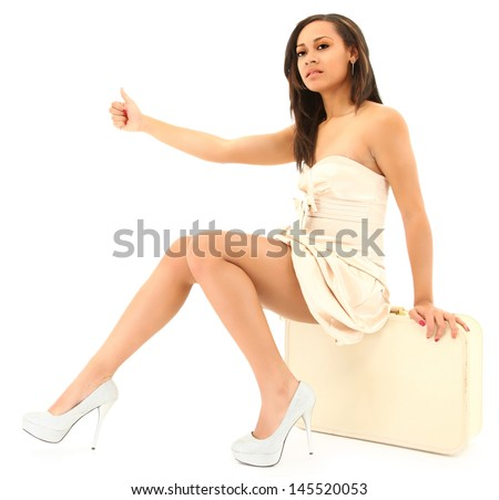 Beautiful Black Woman in Coctail Dress and Suitcase Hitchhiking, Thumb Up - stock photo