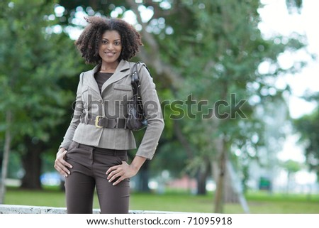 Beautiful black woman in the park - stock photo