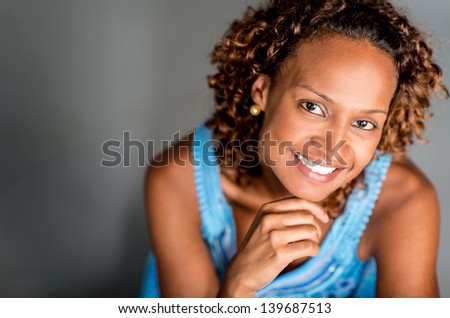 Beautiful black woman looking very happy and smiling - stock photo