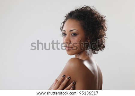 Beautiful black woman posing in a studio .Erotic art photo - stock photo