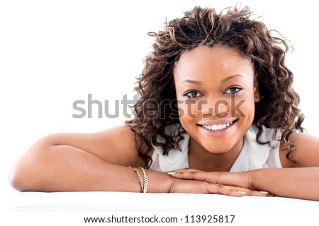 Beautiful black woman smiling - isolated over a white background - stock photo