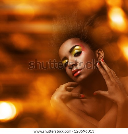 Beautiful black woman with glossy wet makeup - stock photo