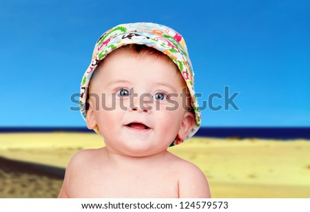 Beautiful blond babe with blue eyes in the beach - stock photo