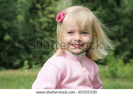 beautiful blond baby girl with wind in her hair - stock photo