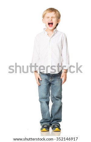 Beautiful blond boy in shirt and jeans opened his mouth and yells. Isolated on white background. Shooting in the studio - stock photo