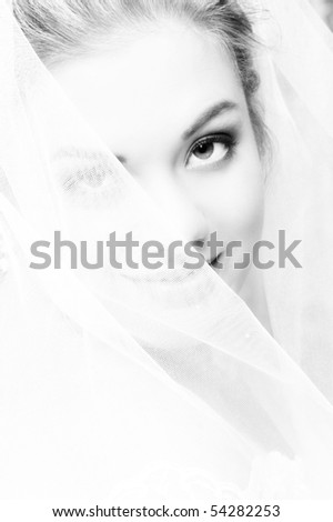 Beautiful blond bride on her wedding day - stock photo