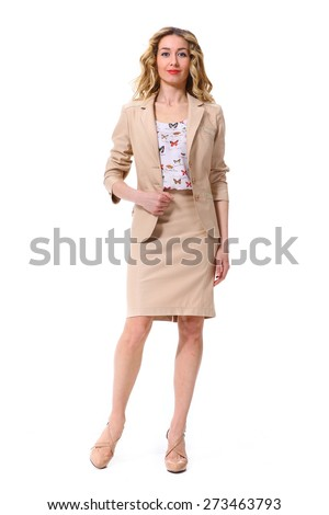 beautiful blond curly business woman in summer beige suit - stock photo