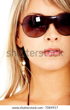beautiful blond fashion woman wearing sunglasses over a white background - stock photo