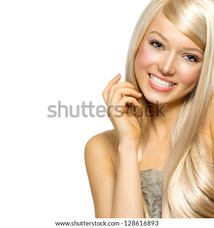 Beautiful Blond Girl isolated on a White Background. Blonde Long Hair. Beautiful Young Woman Portrait. Looking at Camera - stock photo