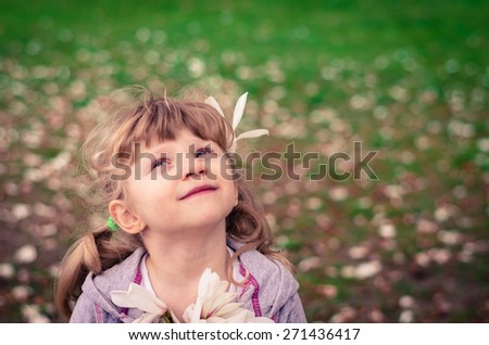 beautiful blond girl looking up - stock photo