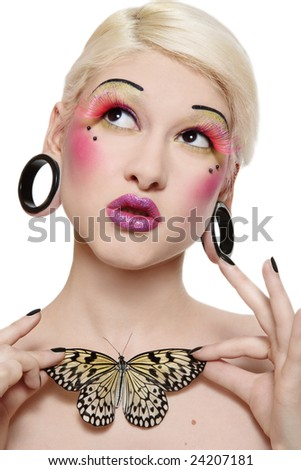 Beautiful blond girl with bright makeup and tropical butterfly in hands - stock photo