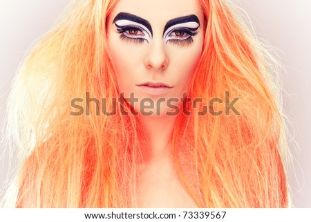 beautiful blond girl with cat eyes makeup - stock photo