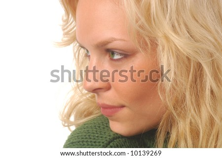 Beautiful blond model in green sweater on a white background with copyspace. - stock photo