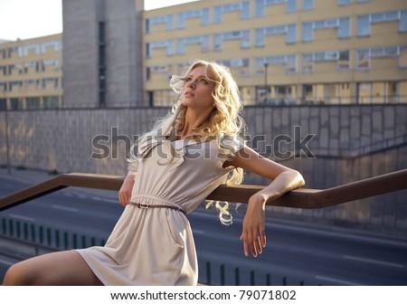 Beautiful blond model outdoor. Street fashion photo. - stock photo