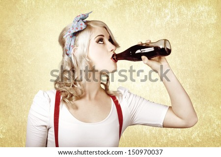 Beautiful blond pinup girl drinking soda drink at vintage sweets shop - stock photo
