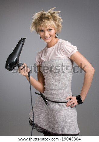 Beautiful blond posing with hairdryer - stock photo