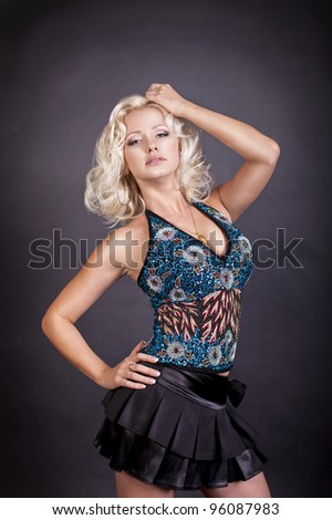 beautiful blond sexy pinup girl in corset. Marilyn Monroe style. Fashion photo - stock photo