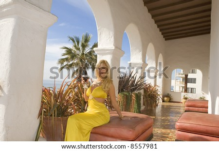 Beautiful Blond sipping Red Wine outdoors at Casa Romantica. - stock photo