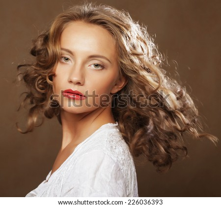 beautiful blond with gorgeous curly hair  - stock photo