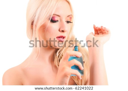 beautiful blond woman applying perfume on her body over white - stock photo