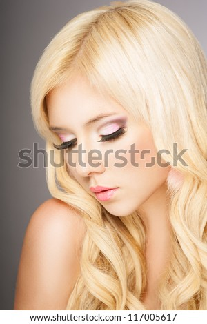 Beautiful blond woman closed eyes, long eyelashes - stock photo