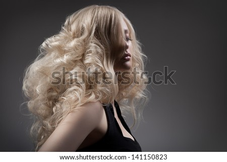 Beautiful Blond Woman. Curly Long Hair - stock photo